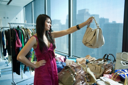 "Intern Samantha DeZur picks out a handbag at the offices of Marie Claire magazines/""Running in Heels"" (photo: Style Network)"